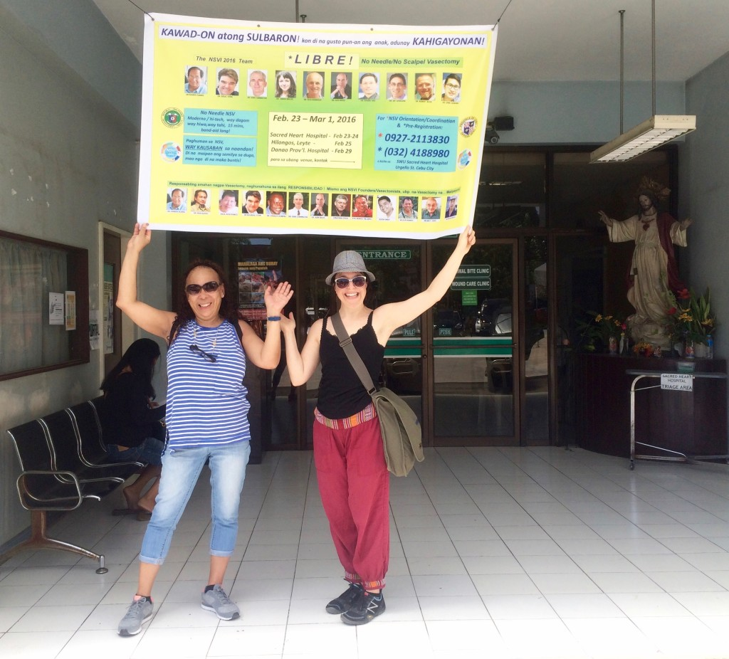 Liz and Sarah with NSVI banner at Sacred Heart Hospital in Cebu