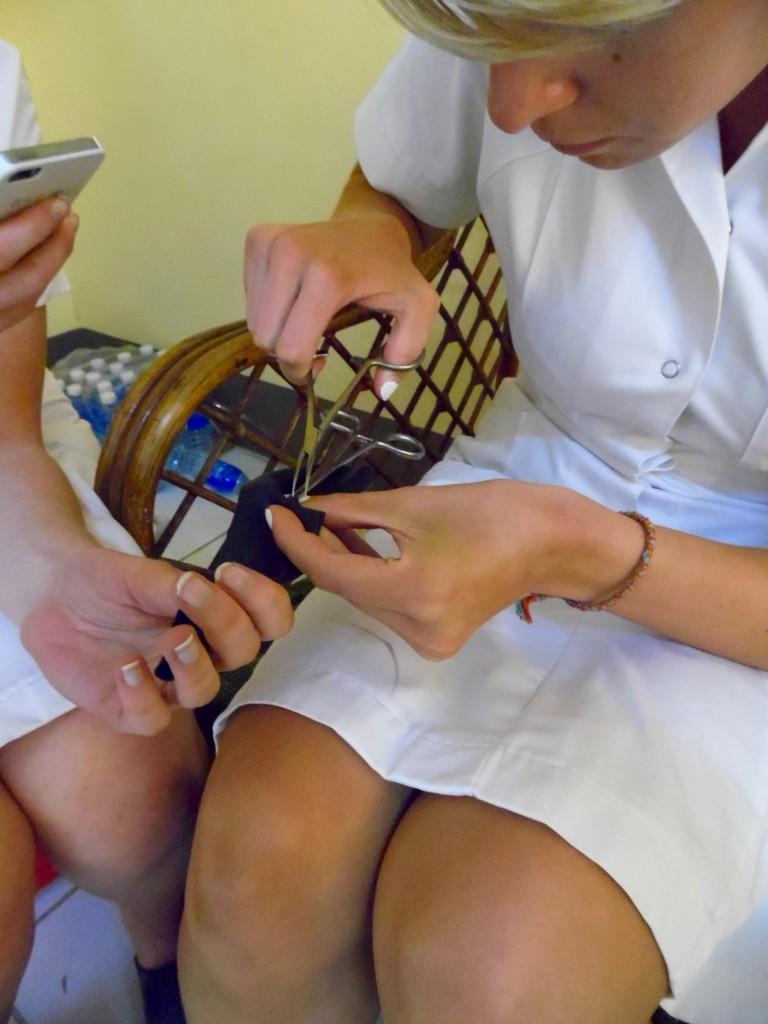 Matilde Poulsen (nursing student from Denmark) learning vasectomy with scrotal model