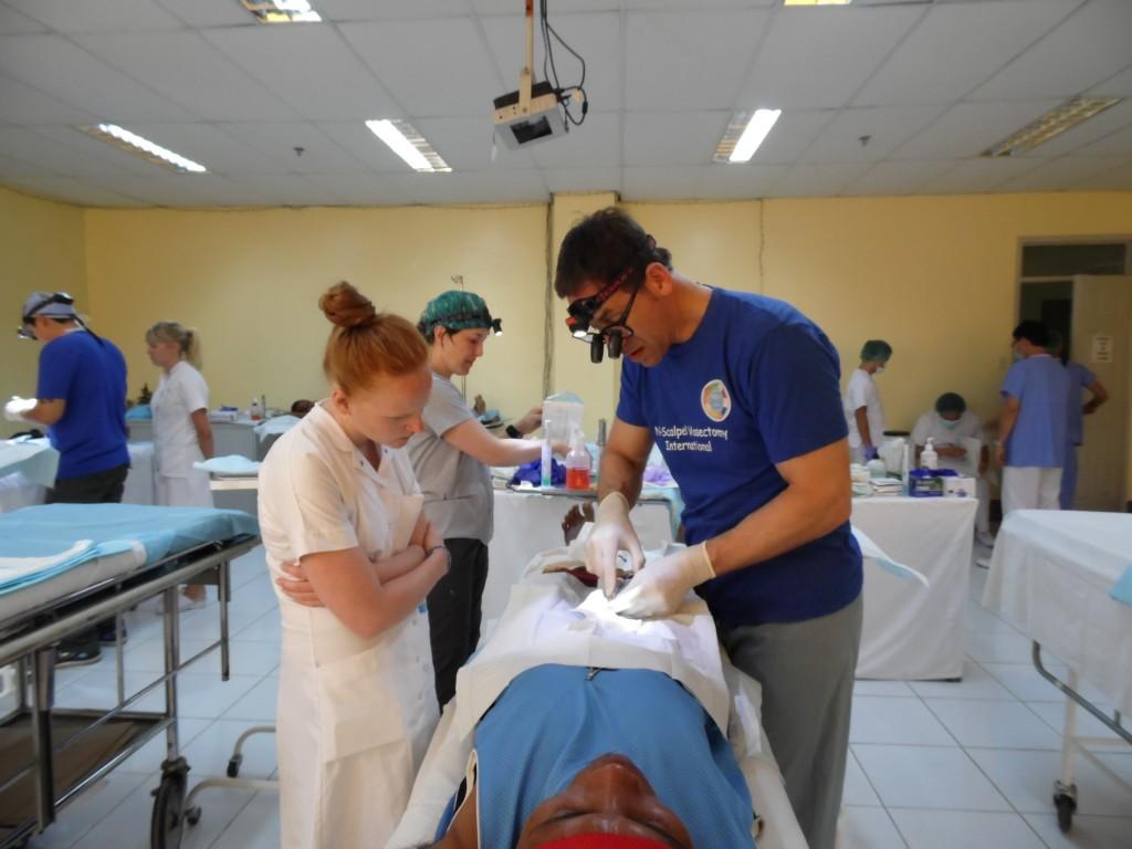 Jay Sandlow doing vasectomy in Danao, Maria Nielsen from Denmark looks on